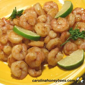 Ingredients of shrimp, honey, and lime stir fry recipe on a yellow plate image.