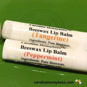 Homemade beeswax lip balm in white tubes with labels image.
