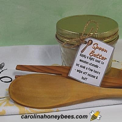 A jar of beeswax spoon butter and a wooden spoon makes a great gift of stocking stuffer image.