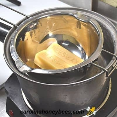 Melting beeswax in a double boiler image.
