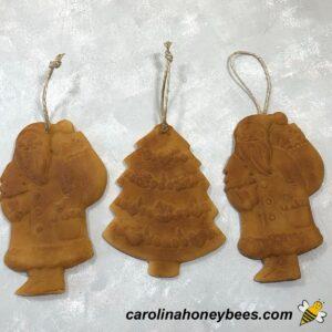 Various beeswax christmas ornaments blackened image.