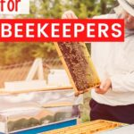 Beekeeper with hive gift ideas image.