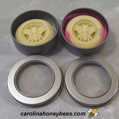 DIY lotion bars in metal tins image.