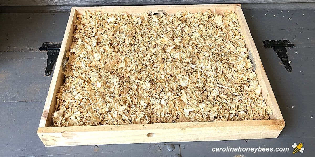 Wooden shim filled with shavings to make a quilt box for a beehive image.