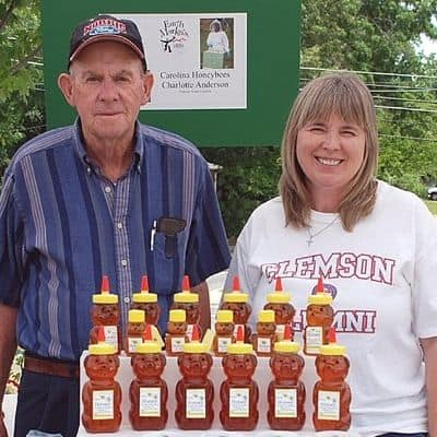 Charlotte and Dad at beekeeping booth image.