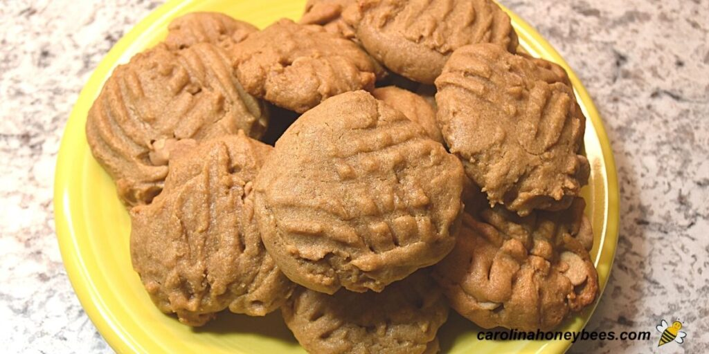 Peanut butter honey cookies on a yellow plate image.