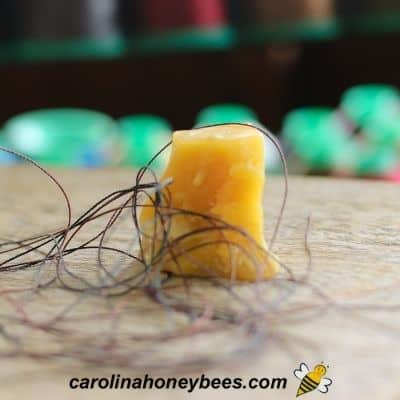 Crumbly cake of beeswax and thread for sewing image.
