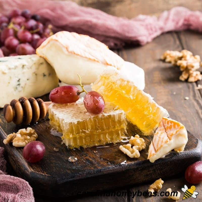 Chunks of cheese and honeycomb on a tray to eat as a pairing image.